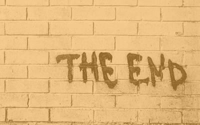 """""""The End"""" written in graffiti on a wall"""